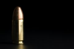 Bullet on black Royalty Free Stock Photography