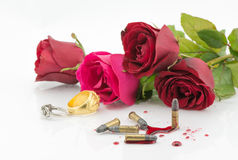 Bullet on blood and red rose on white background Stock Photos
