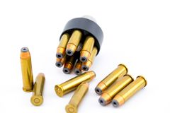 357 bullet cartridges with speed loader. On a bright white backdrop royalty free stock photo