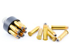 357 bullet cartridges with speed loader. On a beautiful bright white background royalty free stock photo