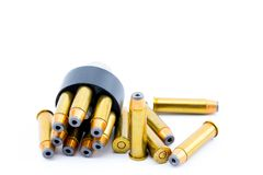 357 bullet cartridges with speed loader. On a beautiful bright white background royalty free stock photos