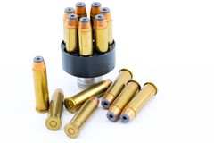 357 bullet cartridges with speed loader. On a beautiful bright white background stock image