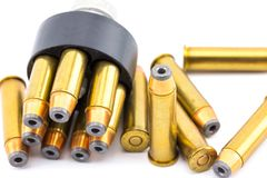 357 bullet cartridges with speed loader. On a bright white backdrop royalty free stock photography