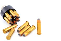 357 bullet cartridges with speed loader. On a white background stock photography
