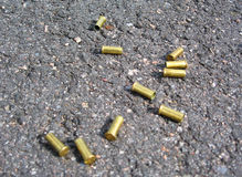 Bullet cases. On street after a shootout Stock Photography