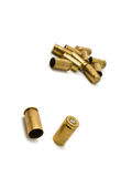 Bullet casings. Empty 9mm bullet casings over white background Royalty Free Stock Photo