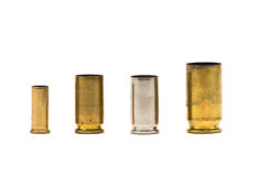 Bullet casings. Different sized bullet casings over white background Stock Images