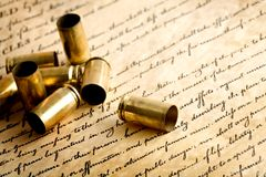Bullet casings on bill of rights. Spent casings, macro with limited dof Stock Images