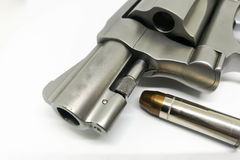 Bullet close-up on 38 Super ammo with a handgun  on white background Stock Photo