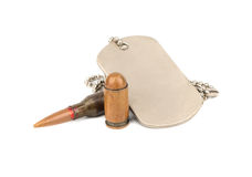 Bullet and dogtag Royalty Free Stock Image