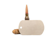 Bullet and dogtag Stock Images