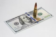 Bullet on the dollar bill. Benjamin Franklin. Bullet on the dollar bill. Benjamin Franklin royalty free stock images