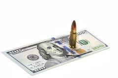 Bullet on the dollar bill. Benjamin Franklin.  stock images