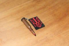 Bullet emblem Royalty Free Stock Photography