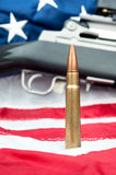Bullet on flag Royalty Free Stock Photo