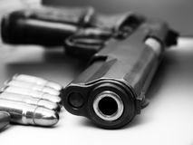 Bullet and gun. Revolver and several bullets, black and white photography Royalty Free Stock Images