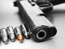 Bullet and gun. 7.62mm caliber revolver and a few bullet-concept Royalty Free Stock Photography