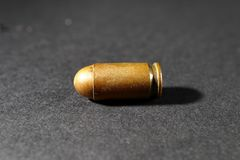 Bullet from a gun on a black background Stock Photo