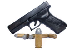 Bullet and Gun. Bullet close up with soft focus gun and ammunition Stock Images