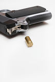 Bullet and gun with copy space Stock Images