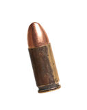 Bullet for a gun. 9mm bullet for a gun isolated on white background Royalty Free Stock Photo
