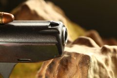 Bullet on gun scene. The old and dirty pistol bullet put on the gun represent the weapon and bullet concept related idea Stock Images