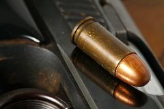 Bullet and gun scene. The pistol and bullet scene represent the weapon abstract concept related idea Stock Image