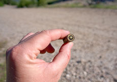 Bullet in hand Stock Image