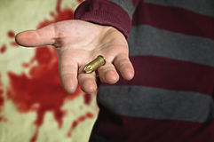Bullet in hand Royalty Free Stock Photo