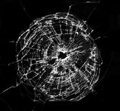 Bullet hit. A background of a pattern formed by a glass hit by a bullet Stock Images