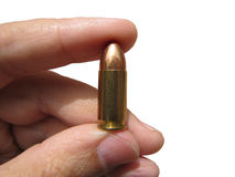 Bullet. Holding bullet with two fingers. full isolated on a white background, close up Royalty Free Stock Photos