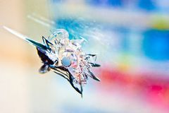Bullet-Hole. A jagged bullet hole in a Baltimore storefront Stock Image