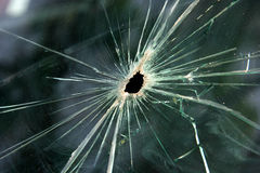 Bullet hole. In the window Royalty Free Stock Photography