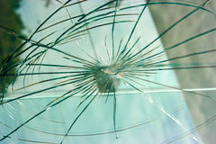 Bullet hole. In the window Royalty Free Stock Photo