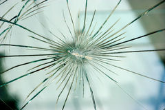 Bullet hole. In the window Stock Photos