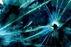 Bullet hole in broken glass. Bullet hole in old cracked broken glass window royalty free stock photos