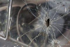 Bullet hole. Car window after a raid has a  bullet hole Royalty Free Stock Photography