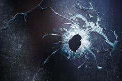 A bullet hole is in glass. Photo broken window looks like a bullet hole Royalty Free Stock Images