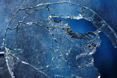 A bullet hole is in glass. Photo broken window looks like a bullet hole Stock Photography