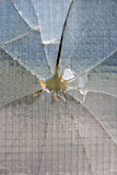 Bullet hole glass. A bullet hole on a window glass - crimi concept Stock Images