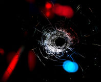 Bullet hole in the glass. Royalty Free Stock Image
