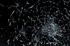 Bullet hole in glass close up on black background. Bullet hole in glass closeup on black background Royalty Free Stock Photos