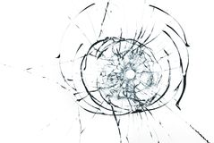 Bullet hole in glass close up on white background. Bullet hole in glass closeup on white background Royalty Free Stock Photos