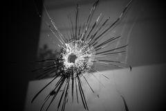 Bullet hole. On glass, Crime and violence Stock Images