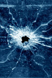 Bullet hole in glass window Royalty Free Stock Photos