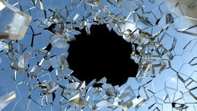 Bullet hole and pieces of shattered blue glass. On black Stock Image