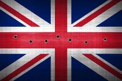 Bullet hole. Shotgun bullet hole on united kingdom flag. metal background. concept design Royalty Free Stock Photography