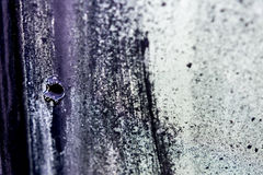 Bullet hole and texture. Royalty Free Stock Image