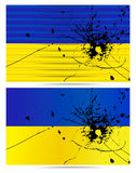 Bullet hole Ukrainian flags Royalty Free Stock Photos