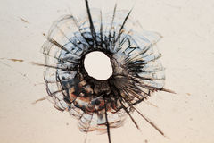 Bullet hole in window. Background Stock Photos